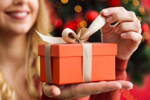 woman-opening-a-orange-gift_23-2147580773