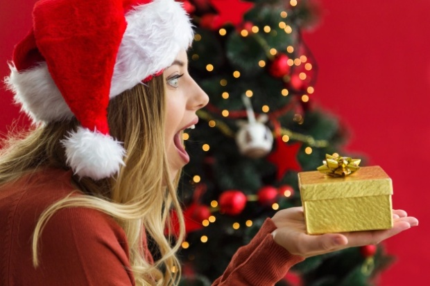 woman-looking-at-a-golden-present_23-2147580776