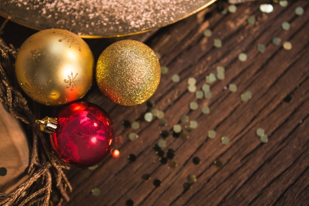 Christmas bauble ball on wooden plank