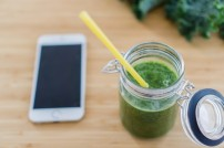 top-view-of-green-juice-with-straw_1156-44